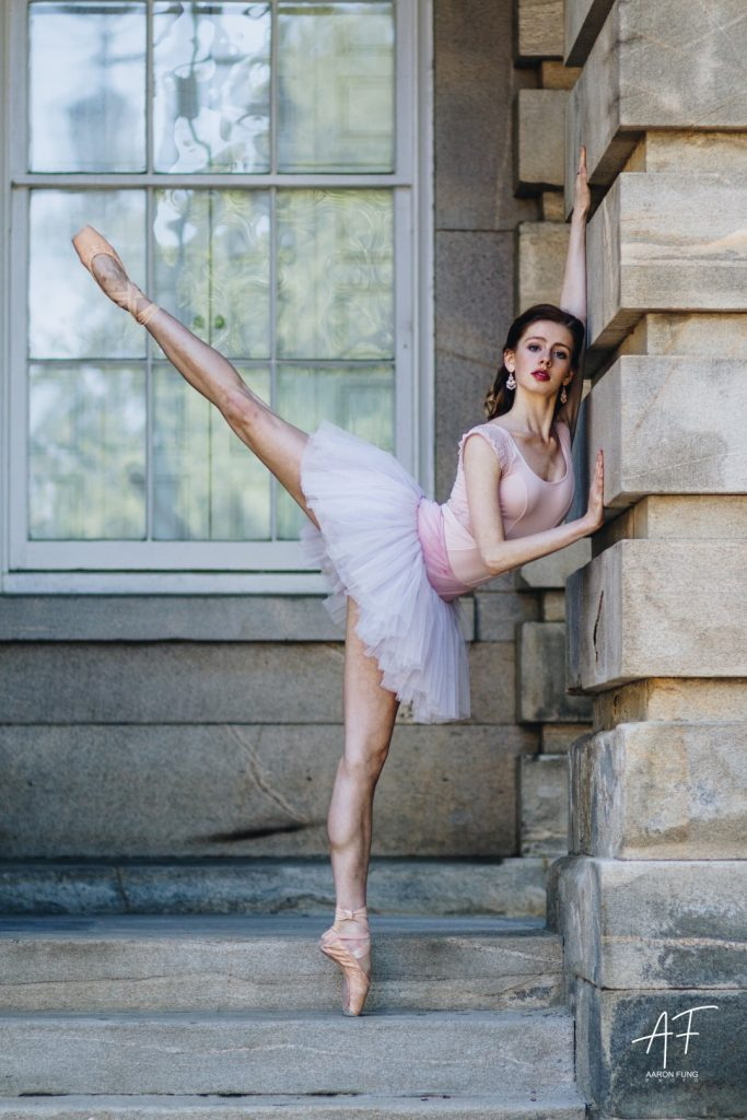 Ballerina posing with old architecture